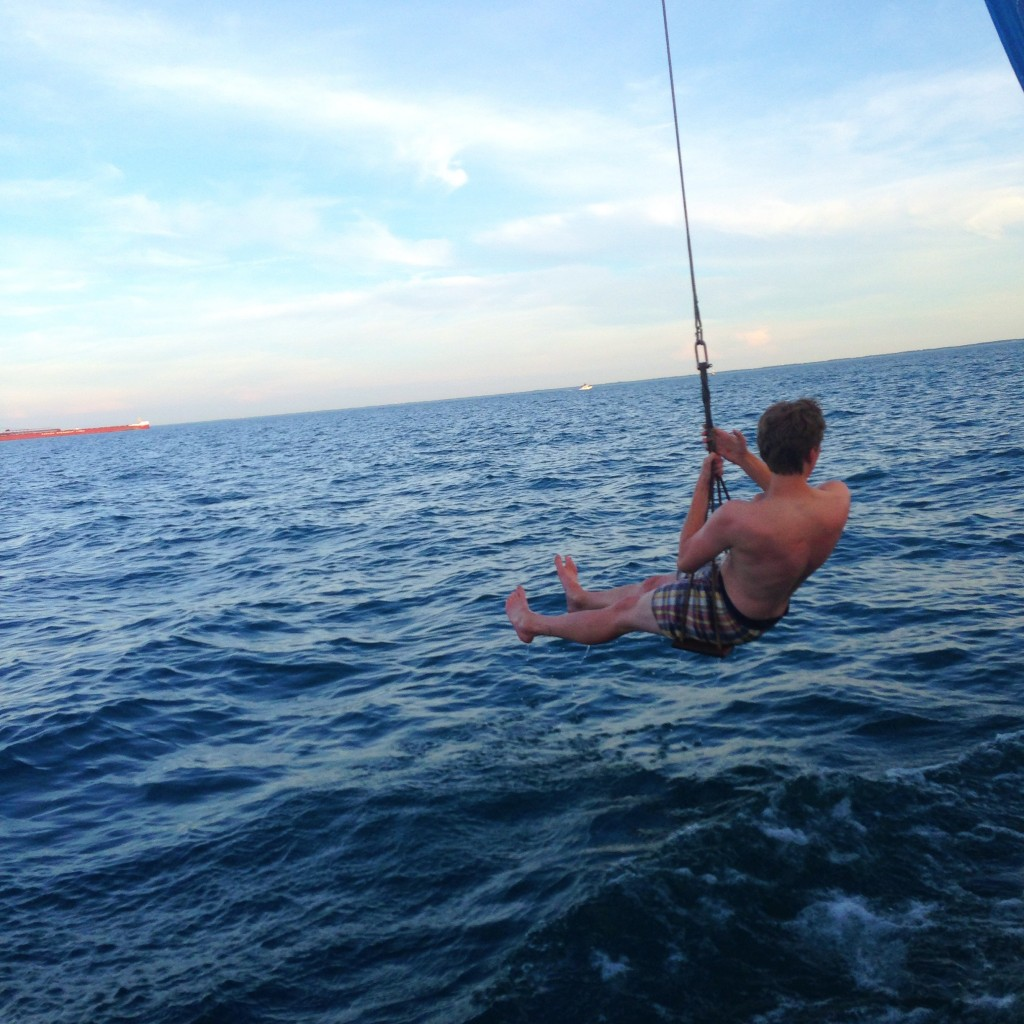 they had a rope swing off of the sailboat, notice the freighter in the background